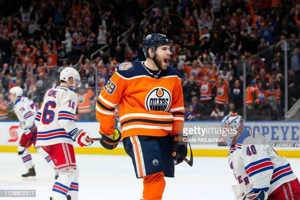 Leon Draisaitl of the Edmonton Oilers scores the winner against the New York Rangers during overtime at Rogers Place on March 11 2019 in Edmonton...