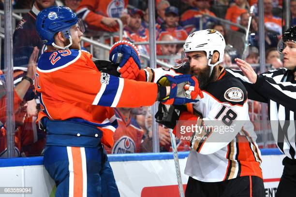 Leon Draisaitl of the Edmonton Oilers scrums with Patrick Eaves of the Anaheim Ducks on April 1 2017 at Rogers Place in Edmonton Alberta Canada