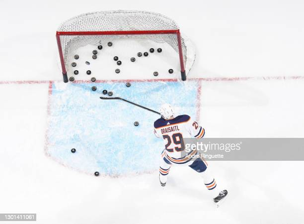 Leon Draisaitl of the Edmonton Oilers shoots pucks into the net during warmup prior to a game against the Ottawa Senators at Canadian Tire Centre on...