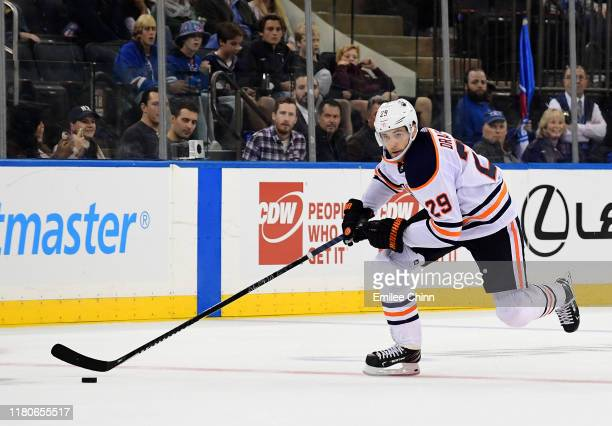 Leon Draisaitl of the Edmonton Oilers skates down the ice to score an open net goal in the third period against the New York Rangers at Madison...