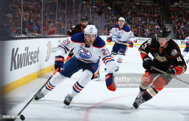 Leon Draisaitl of the Edmonton Oilers skates with the puck against Cam Fowler of the Anaheim Ducks during the game on March 22 2017 at Honda Center...