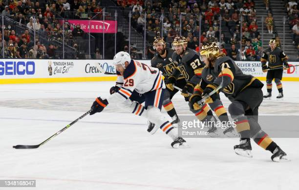 Leon Draisaitl of the Edmonton Oilers skates with the puck ahead of Alex Pietrangelo, Shea Theodore and William Karlsson of the Vegas Golden Knights...