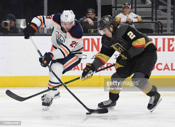Leon Draisaitl of the Edmonton Oilers skates with the puck under pressure from Zach Whitecloud of the Vegas Golden Knights in the third period of...