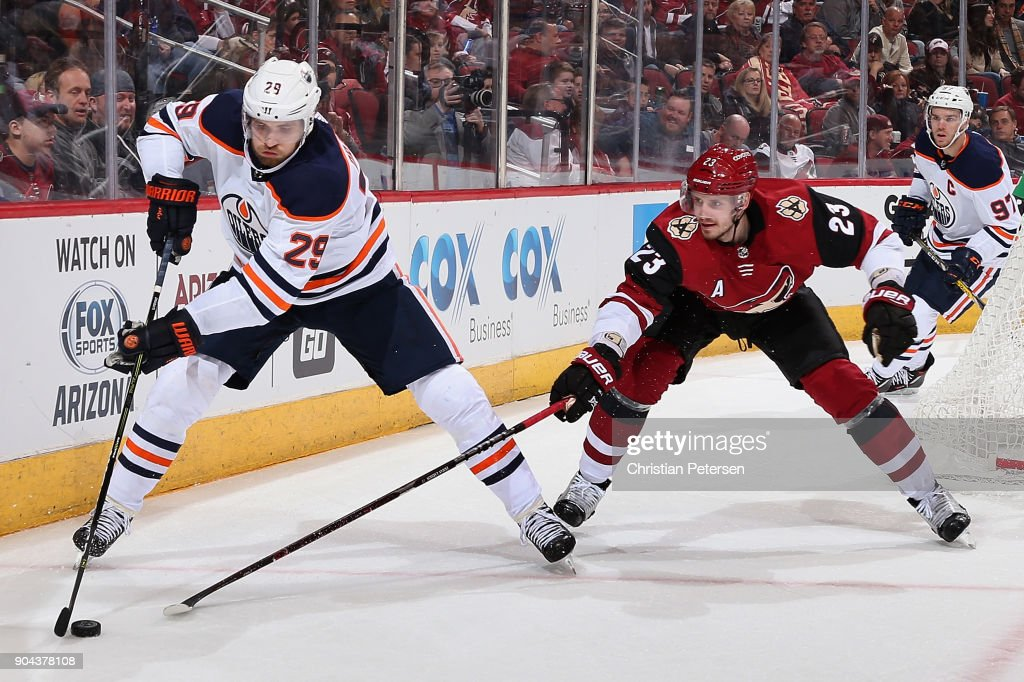 Leon Draisaitl #29 of the Edmonton Oilers skates with the puck under pressure from Oliver Ekman-Larsson #23 of the Arizona Coyotes during the second period of the NHL game at Gila River Arena on January 12, 2018 in Glendale, Arizona. The Oilers defeated the Coyotes 4-2.