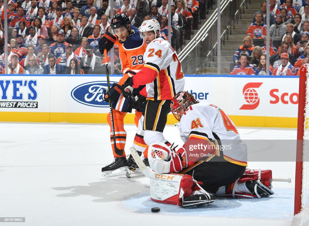Leon Draisaitl #29 of the Edmonton Oilers takes a shot on Mike Smith #41 of the Calgary Flames on October 4, 2017 at Rogers Place in Edmonton, Alberta, Canada.