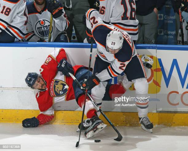 Leon Draisaitl of the Edmonton Oilers takes the puck from Vincent Trocheck of the Florida Panthers at the BBT Center on March 17 2018 in Sunrise...