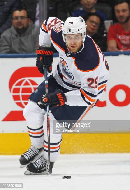Leon Draisaitl of the Edmonton Oilers turns up ice with the puck against the Toronto Maple Leafs during an NHL game at Scotiabank Arena on February...