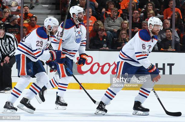 Leon Draisaitl Patrick Maroon and Adam Larsson of the Edmonton Oilers celebrate a goal in the third period in Game One of the Western Conference...