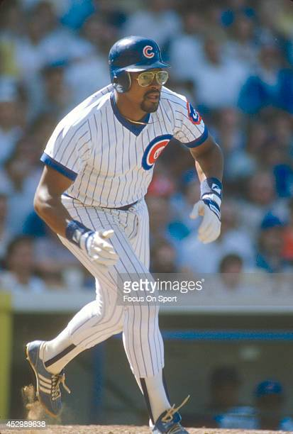 Leon Durham of the Chicago Cubs puts the ball in play and heads up the first base line during an Major League Baseball game circa 1984 at Wrigley...
