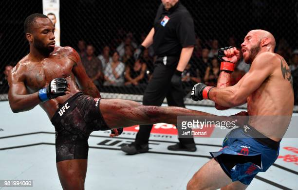 Leon Edwards of Jamaica kicks Donald Cerrone in their welterweight bout during the UFC Fight Night event at the Singapore Indoor Stadium on June 23...