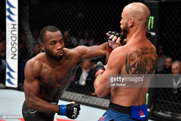 Leon Edwards of Jamaica punches Donald Cerrone in their welterweight bout during the UFC Fight Night event at the Singapore Indoor Stadium on June 23...