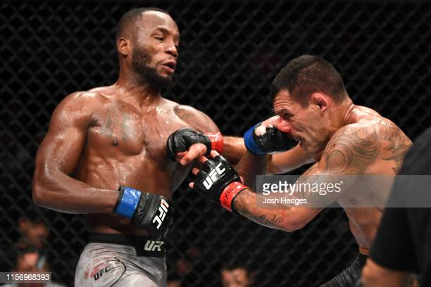 Leon Edwards of Jamaica punches Rafael Dos Anjos of Brazil in their welterweight bout during the UFC Fight Night event at AT&T Center on July 20,...