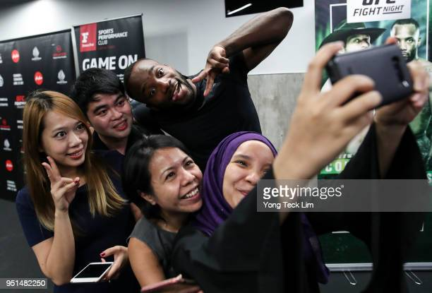 Leon Edwards poses for photos with fans after teaching an MMA seminar at Fitness First gym on April 26 2018 in Singapore