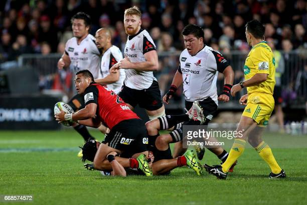 Leon Fukofuka of the Crusaders tlooks to pass the ball during the round eight Super Rugby match between the Crusaders and the Sunwolves at AMI...