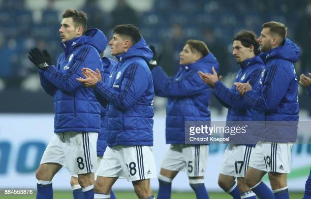 Leon Goretzka and Alessandro Schoepf of Schalke look dejected afte the 22 draw of the Bundesliga match between FC Schalke 04 and 1 FC Koeln at...