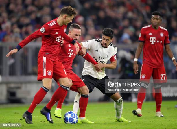 Leon Goretzka and Franck Ribery of Bayern Munich battle with Andre Almeida of Benfica during the UEFA Champions League Group E match between FC...