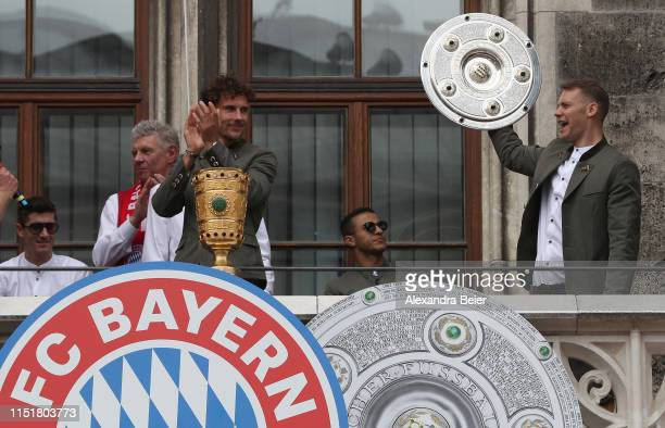 Leon Goretzka and goalkeeper manuel Neuer of FC Bayern Muenchen celebrate winning the Bundesliga title and the German Cup title for the season...
