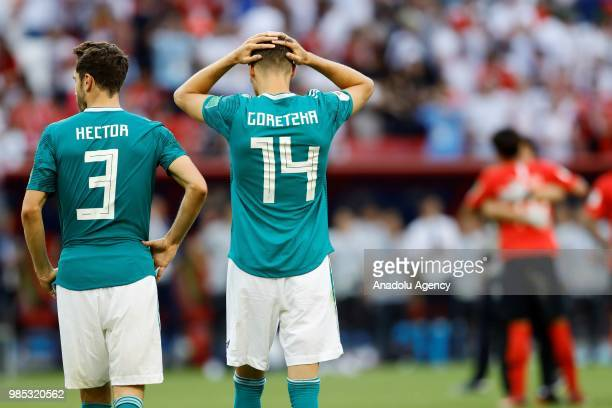 Leon Goretzka and Hector of Germany react after losing the 2018 FIFA World Cup Russia Group F match against Korea Republic at the Kazan Arena in...