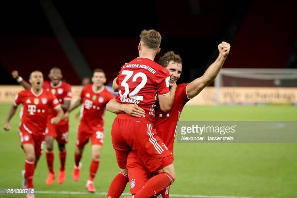 Leon Goretzka and Joshua Kimmich of Bayern Muenchen celebrate the 4th team goal during the DFB Cup final match between Bayer 04 Leverkusen and FC...