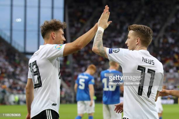 Leon Goretzka and Marco Reus of Germany celebrate after scoring during the UEFA Euro 2020 Qualifier match between Germany and Estonia at Opel Arena...