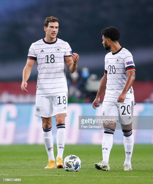 Leon Goretzka and Serge Gnabry of Germany react after Ferran Torres of Spain scored his team's second goal with teammates during the UEFA Nations...