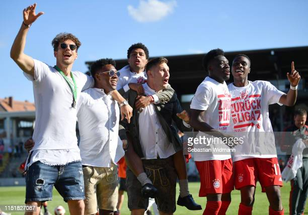 Leon Goretzka David Alaba Serge Gnarby and Niklas Suele of Bayern Muenchen celebrate with Alphonso Davies and Maxime Awoudja of Bayern Muenchen II...