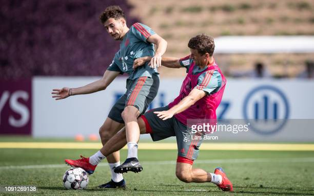 Leon Goretzka is challenged by Thomas Mueller during a training session at day five of the Bayern Muenchen training camp at Aspire Academy on January...