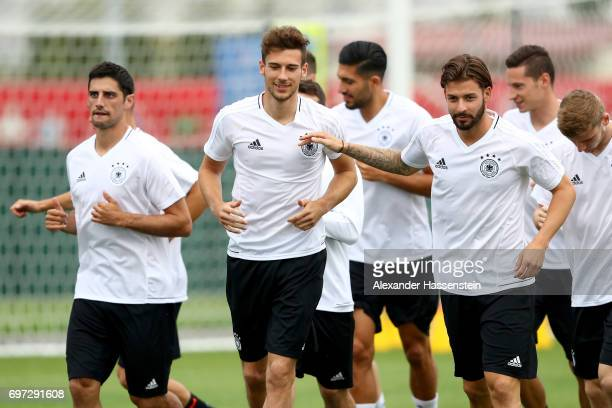 Leon Goretzka jokes with Marvin Plattenhardt during a team Germany training session at Park Arena training ground on June 18 2017 in Sochi Russia...