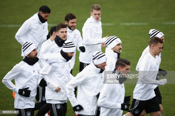 Leon Goretzka looks on as players run during a Germany training session ahead of their international friendly match against Spain at PaulJanesStadion...
