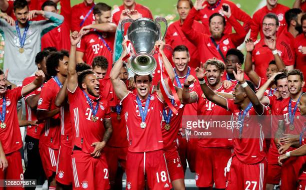 Leon Goretzka of Bayern Muenchen celebrates with the trophy and his teammates during the UEFA Champions League Final match between Paris SaintGermain...