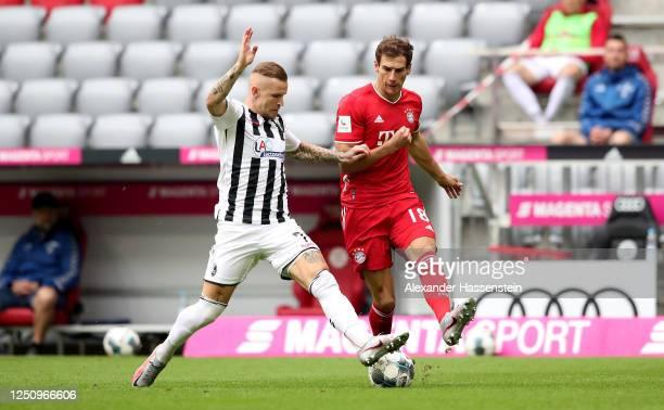 Leon Goretzka of Bayern Muenchen challenges Jonathan Schmid of Freiburg during the Bundesliga match between FC Bayern Muenchen and Sport-Club...