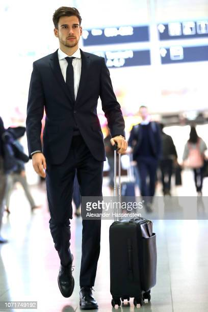 Leon Goretzka of Bayern Muenchen makes his way through the airport prior to the departure of the team to the UEFA Champions League match against AFC...