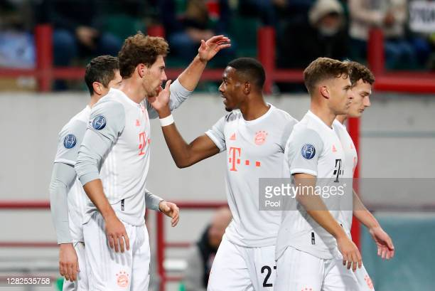 Leon Goretzka of Bayern Munich celebrates with David Alaba after scoring his team's first goal during the UEFA Champions League Group A stage match...