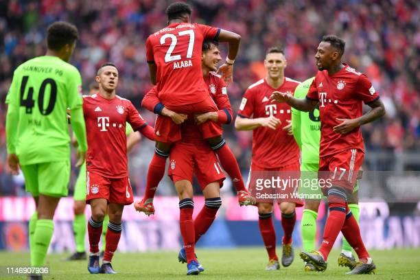 Leon Goretzka of Bayern Munich celebrates with teammates after scoring his team's second goal during the Bundesliga match between FC Bayern Muenchen...