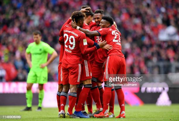 Leon Goretzka of Bayern Munich celebrates with teammates after scoring his team's second goal during the Bundesliga match between FC Bayern Muenchen...