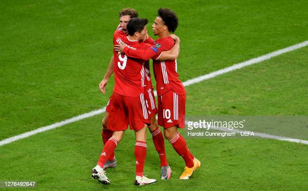 Leon Goretzka of Bayern Munich celebrates with teammates after scoring his team's first goal during the UEFA Super Cup match between FC Bayern Munich...