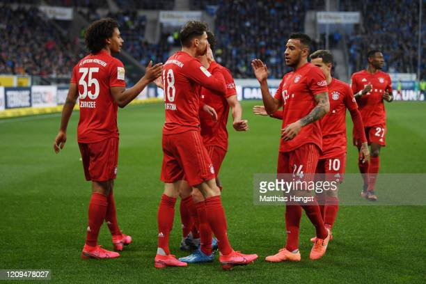 Leon Goretzka of Bayern Munich celebrates with teammates Joshua Zirkzee and Corentin Tolisso after scoring his sides sixth goal during the Bundesliga...