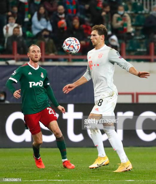 Leon Goretzka of Bayern Munich is challenged by Vladislav Ignatyev of Lokomotiv Moscow during the UEFA Champions League Group A stage match between...