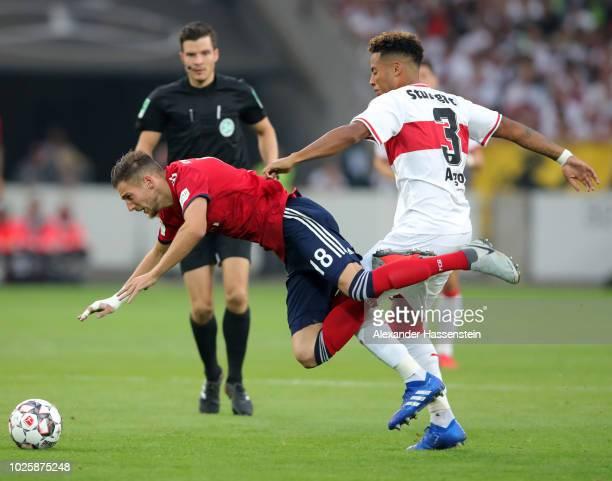 Leon Goretzka of Bayern Munich is tackled by Dennis Aogo of VfB Stuttgastock during the Bundesliga match between VfB Stuttgart and FC Bayern Muenchen...