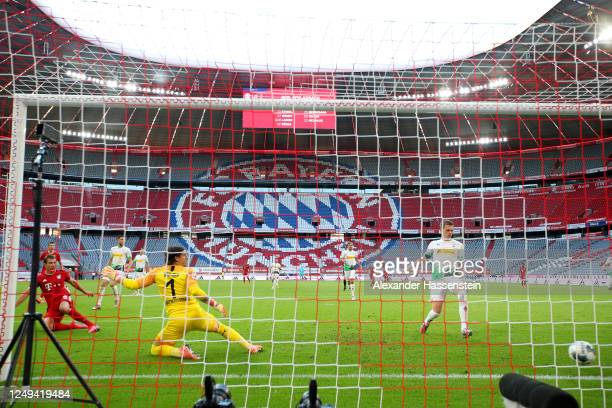 Leon Goretzka of Bayern Munich scores his team's second goal past Yann Sommer of Borussia Monchengladbah during the Bundesliga match between FC...