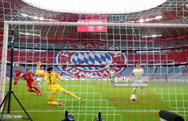 Leon Goretzka of Bayern Munich scores his team's second goal past Yann Sommer of Borussia Monchengladbah during the Bundesliga match between FC...