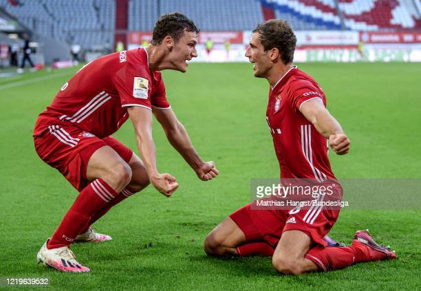 Leon Goretzka of FC Bayern München celebrates with teammate Benjamin Pavard of FC Bayern München after scoring his team's second goal during the...