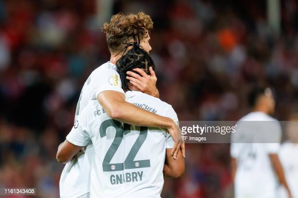 Leon Goretzka of FC Bayern Muenchen celebrates after scoring his team's third goal with team mates during the DFB Cup first round match between...