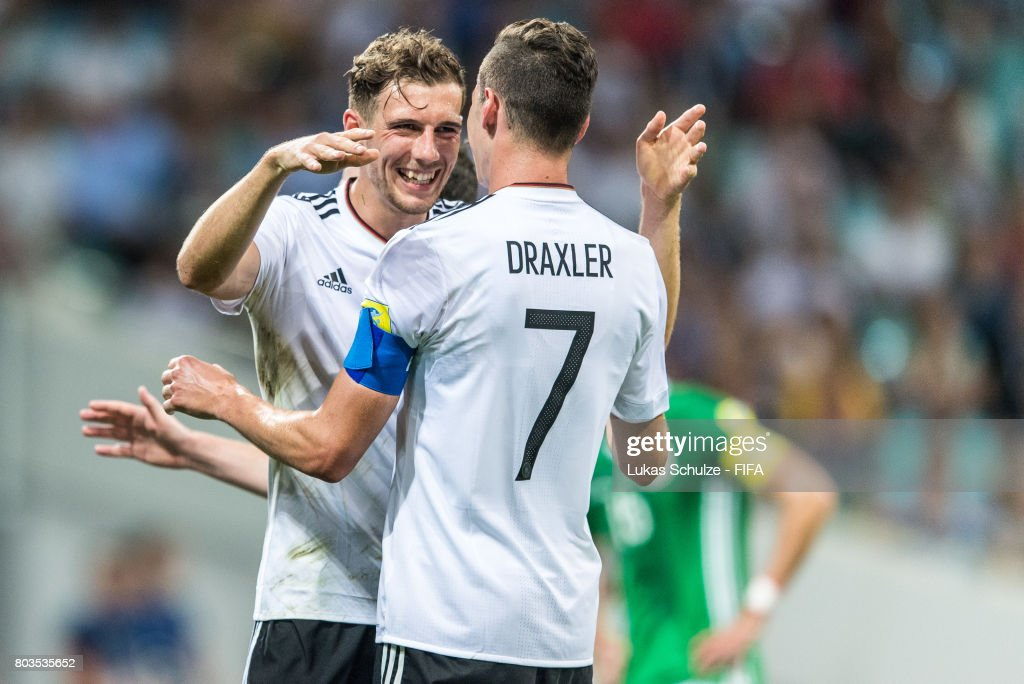 Leon Goretzka (L) of Germany and Julian Draxler (R) of Germany reacts after a goal during the FIFA Confederations Cup Russia 2017 Semi-Final match between Germany and Mexico at Fisht Olympic Stadium on June 29, 2017 in Sochi, Russia.