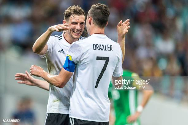 Leon Goretzka of Germany and Julian Draxler of Germany reacts after a goal during the FIFA Confederations Cup Russia 2017 SemiFinal match between...