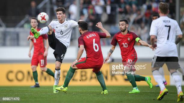 Leon Goretzka of Germany and Ruben Neves of Portugal battle for the ball during the U21 International Friendly match between Germany U21 and Portugal...