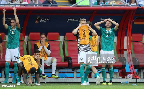 Leon Goretzka of Germany Antonio Ruediger of Germany Matthias Ginter of Germany Jonas Hector of Germany reacts following there team's loss during the...