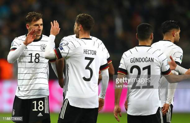 Leon Goretzka of Germany celebrates with Jonas Hector after scoring his team's fifth goal during the UEFA Euro 2020 Qualifier between Germany and...