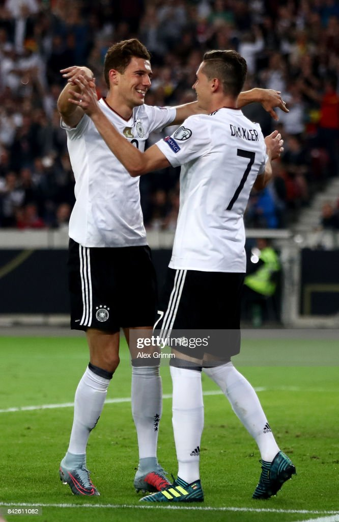 Leon Goretzka of Germany celebrates with Julian Draxler of Germany after scoring his teams fifth goal during the FIFA 2018 World Cup Qualifier between Germany and Norway at Mercedes-Benz Arena on September 4, 2017 in Stuttgart, Baden-Wuerttemberg.