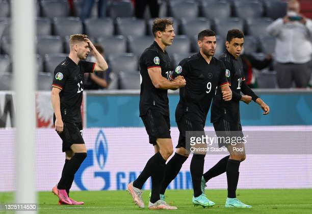 Leon Goretzka of Germany celebrates with Kevin Volland and team mates after scoring their side's second goal during the UEFA Euro 2020 Championship...